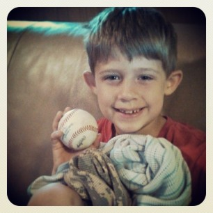 someone got a game ball yesterday. hasn't let go of it since.