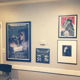all office art finally hung. apparently I'm one Star Wars art piece short.