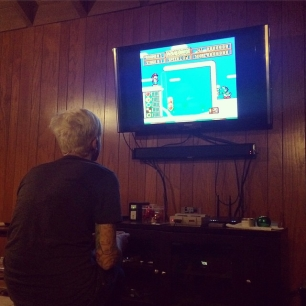 why yes, that IS sarcasmically playing Yoshi's Cookie on the SNES.