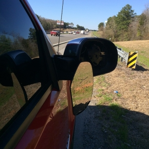 apparently my GIANT RED PICKUP TRUCK wasn't visible enough for this person on the interstate to run into me.