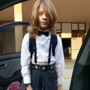 it's picture day. the boy dressed himself.